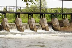 An old dam of piling water in a river. Royalty Free Stock Photos