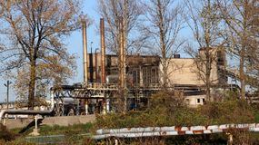 Europe. Poland. Yaslo/Jaslo. Old juices factory `Pectovin` with pipes behind the trees royalty free stock photos