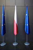 Europe and Polish Flags. Floating in a European conference in Poland with neutral background Royalty Free Stock Photos