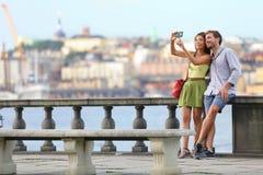 Europe romantic couple tourists in Stockholm. Europe travel. Romantic couple tourists in Stockholm taking selfie photo having fun enjoying skyline view and river Stock Photo