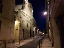 Europe. south of France. Provence. Vaucluse. Avignon. Illiminated church on the night street in downtown. Night view of city royalty free stock images