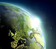 Europe from space during sunrise. Sunrise above Europe. Concept of new beginning, hope, light. 3D illustration with detailed planet surface, atmosphere and city Stock Photo