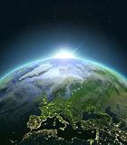 Europe from space during sunrise. Sunrise above Europe. Concept of new beginning, hope, light. 3D illustration with detailed planet surface, atmosphere and city Royalty Free Stock Images