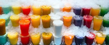 Europe Spain Catalonia Barcelona. A glass of fruit smoothie in the ice in the market.  stock images