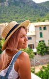 Europe Spain travel vacation. Happy woman in sun hat enjoying at view on village in the Tramuntana mountains. Amazing. View Royalty Free Stock Photos