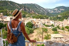 Europe Spain travel vacation. Happy woman in sun hat enjoying at view on village in the Tramuntana mountains. Amazing. View Stock Images
