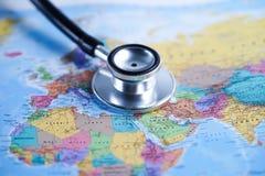 Europe : Stethoscope with world map. Europe : Stethoscope with globe world map stock photos