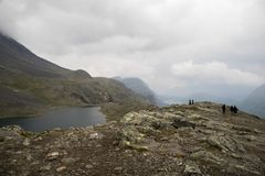 Mountain hiking in Norway. Europe summer travel in mountains and lakes of Scandinavia Royalty Free Stock Photo