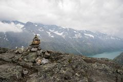 Mountain hiking in Norway. Europe summer travel in mountains and lakes of Scandinavia Royalty Free Stock Photography