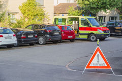 Europe,Switzerland, Schaffhausen - Parking ambulance and prohibiting road sign near the house September 28,  2015 Royalty Free Stock Photography