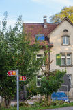 Europe,Switzerland, Schaffhausen,Residential building, car and signage for cyclists-September 28,  2015. Europe Stock Photo