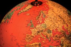 Europe on terrestrial globe and black background Stock Photos