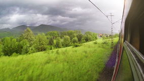 Europe train wide angle Tatra mountains view out the window Royalty Free Stock Images
