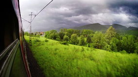 Europe train wide angle Tatra mountains view out the window. 
