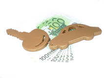 Europe travel concept. Golden key and seven hundred euros. Car key with trinket Stock Images