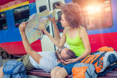 Europe travel couple looking at touristic map in Belgrade Stock Image