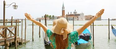 Europe travel vacation fun summer woman with arms up and hat hap. Py in Venice, Italy. Carefree girl tourist in European destination wearing green fashion dress stock photos