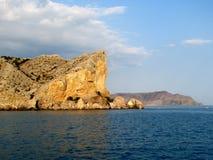 Europe. Ukrainian riviera. Crimea. Region of Sudak seaside city. Riff in sunset on the Black sea. Beautiful seascapes view with Ge Royalty Free Stock Photo