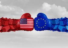 Europe USA Trade Fight. And economic war with American tariffs as two opposing fist freight containers in European Union as an economy dispute over import and Royalty Free Stock Image