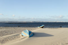Europe windy beach estuary landscape. Boat on the windy beach at tagus river estuary Stock Photography