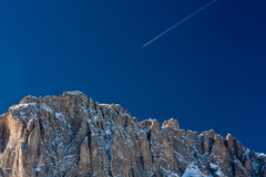 Europe winter holiday concept. Plane arriving in alps region Royalty Free Stock Photography