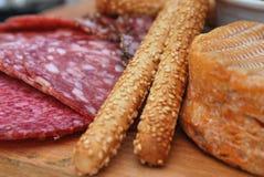 Europeam food on chopping boar Royalty Free Stock Photos
