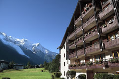 European alpine ski chalet hotel, view of the Alps in distance, copy space Royalty Free Stock Photo