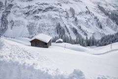 Lots of snow on it in the village warth austria with wooden barn royalty free stock photos