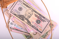 European and american money on wooden basket Royalty Free Stock Photo