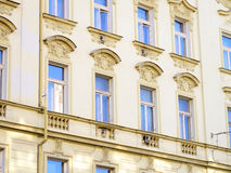 European apartment exterior facade detail, blue sky reflective w Royalty Free Stock Photography