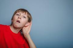European appearance  boy overhears  a decade Stock Photo