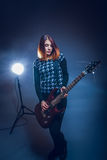 European appearance haired girl playing guitar  Royalty Free Stock Photography