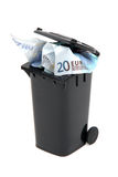 European bank notes in black rubbish bin Stock Image