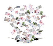 European bank notes falling in black hole Stock Photo