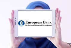 European Bank for Reconstruction and Development logo. Logo of European Bank for Reconstruction and Development , EBRD, on samsung tablet holded by arab muslim royalty free stock photography