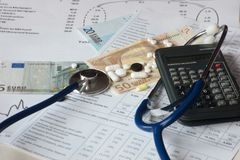 European banknotes with stethoscope and drugs. Suggestion on health care costs Royalty Free Stock Photography