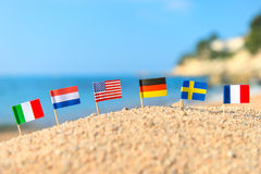 European beach with flags. European beach with row little flags royalty free stock images