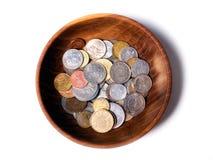 European bowl. Wooden bowl with old European coins Stock Photo