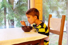 European boy eating Breakfast Stock Image