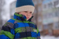 European boy with an emotion of resentment on the street in winter Stock Images