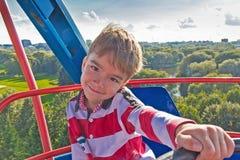 European boy on a Ferris wheel Stock Photos
