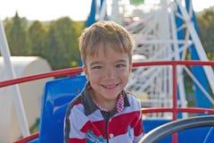 European boy on a Ferris wheel Royalty Free Stock Photo