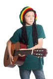 European boy with guitar and hat with dreadlocks royalty free stock photography