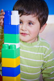 European boy playing with plastic colorful blocks Royalty Free Stock Photo