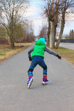 European boy riding on roller skates Stock Image