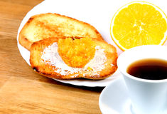 European breakfast: cup of coffee, toasts with jam and orange Royalty Free Stock Image