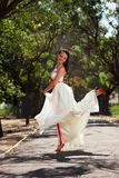 European bride dancing in the park Royalty Free Stock Photography
