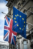 European and British flags together outside grand building Royalty Free Stock Photography
