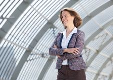 European business woman smiling with arms crossed Royalty Free Stock Images