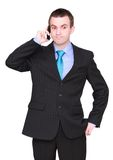 European businessman with cell phone. Isolated Stock Images